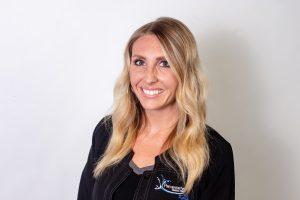 Headshot of Krystal Rydberg, RN wearing a black jacket
