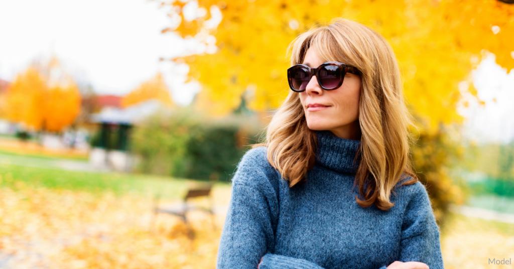 Woman outside during the fall wearing sunglasses near Omaha, NE